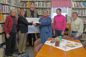 Left to right: Arlene Rhodes, President, Board of Trustees: Brenda Reilly of BSNB; Fred Baily; Debra Flint, Library Manager; Judith Knowlton; Jim Hodsell